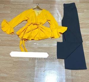 Yellow Peplum Top and Black Trouser | Clothing for sale in Lagos State, Gbagada