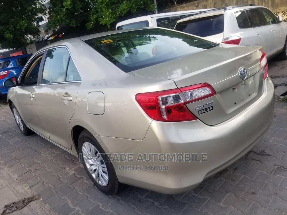 Archive: Toyota Camry 2014 Gold