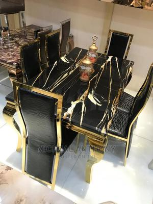 6 Seaters Marble Dining Table Gold Colour With Six Chairs   Furniture for sale in Lagos State, Victoria Island