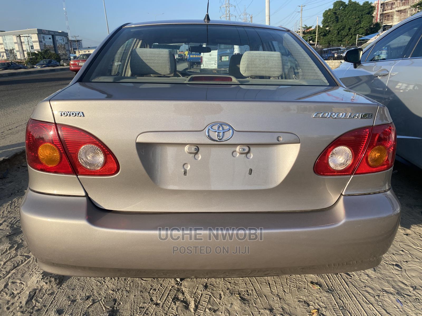 Archive: Toyota Corolla 2002 1.8 Sedan Automatic Gold