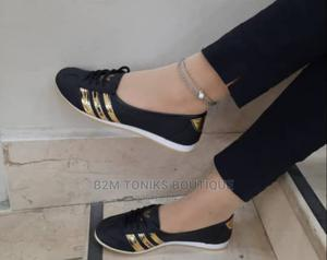 Black and Gold Flat Sneakers | Shoes for sale in Lagos State, Oshodi