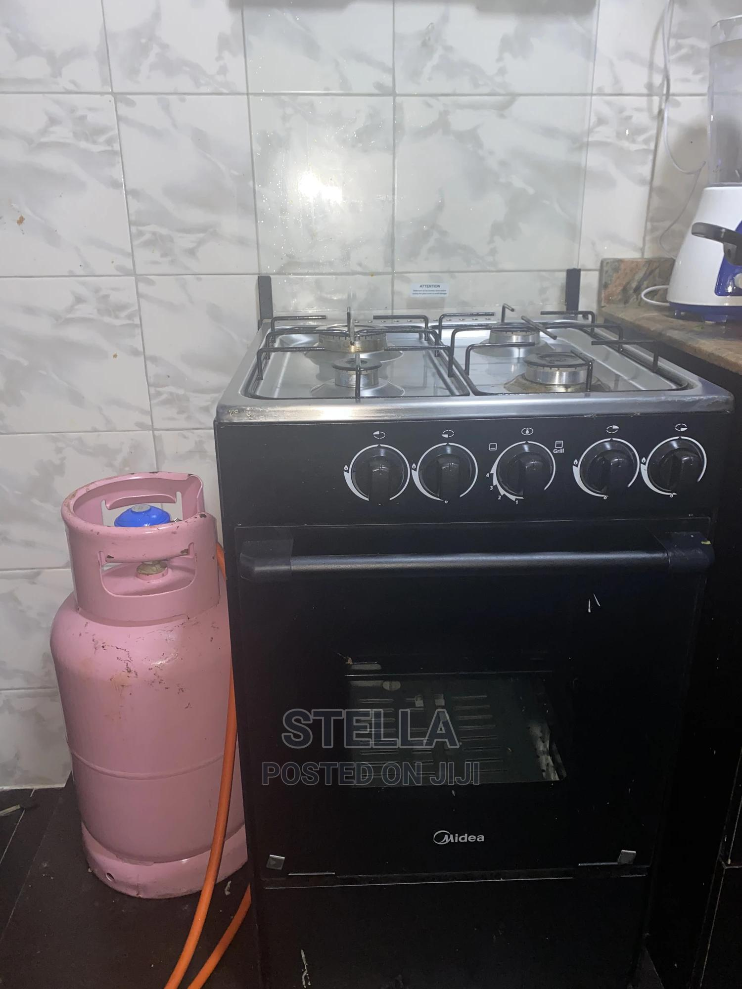 Archive: Fairly Used Midea Gas Cooker With Cylinder for Sale