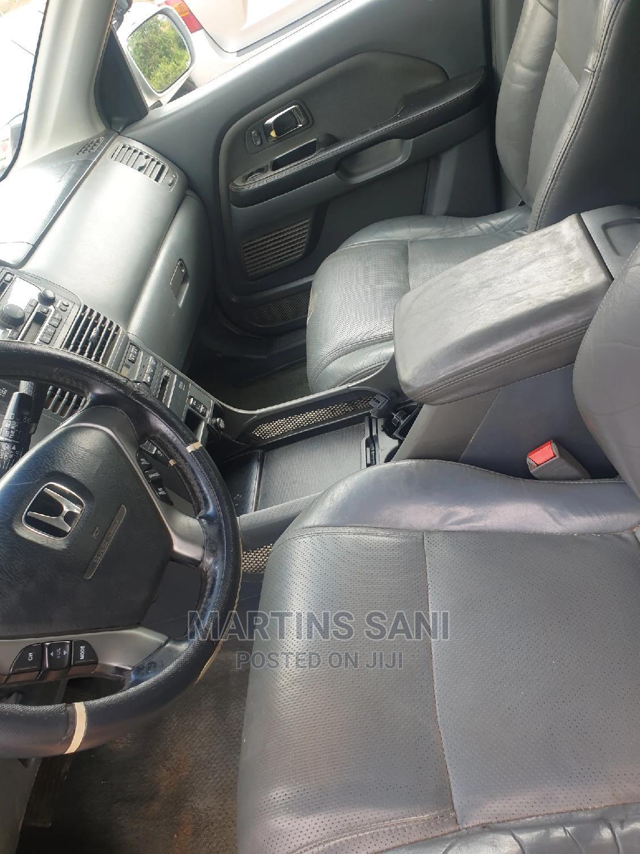 Archive: Honda Pilot 2004 EX 4x4 (3.5L 6cyl 5A) Silver