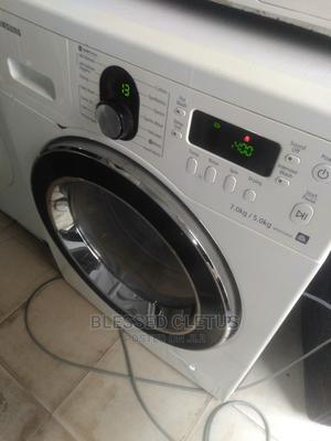 Clean Samsung 7kg +5 Washing and Drying Front Loader | Home Appliances for sale in Lagos State, Ojo