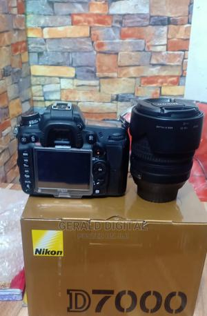Nikon D7000 Camera. The Lens 18 - 105mm.   Photo & Video Cameras for sale in Lagos State, Ojo