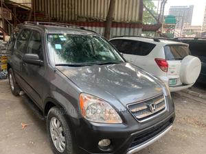 Honda CR-V 2006 LX 4WD Automatic Gold | Cars for sale in Lagos State, Ojodu