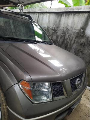 Nissan Frontier 2009 Crew Cab LE 4x4 Brown | Cars for sale in Rivers State, Obio-Akpor