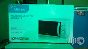 Midea Microwave Oven Mm720ca7-pm   Kitchen Appliances for sale in Lagos State, Ojo